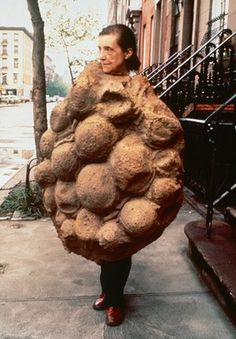 Louise Bourgeois, pictured 1975, wearing her latex sculpture Avenza (1968–69), which became part of Confrontation (1978).