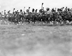 War dance, 1934 Ngāti Tūwharetoa men perform the Peruperu, a war dance with weapons. At the right moment all the warriors would leap in the air in unison, which is an awesome sight designed to put fear into the enemy. Peru, Maori Songs, Waitangi Day, Maori Tribe, Polynesian People, West Papua, Maori Designs, Maori Art, Kiwiana