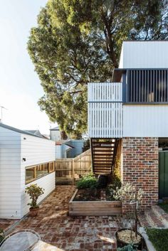 Lawry Street Residence is a beautifully renovated home tucked away in Melbourne's inner-north suburb of Northcote. Facade Design, Exterior Design, House Design, Outdoor Spaces, Outdoor Living, White Exterior Houses, Weatherboard House, Street House, Australian Homes