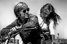 """Robert Redford and Lauren Hutton on the set of """"Little Fauss and Big Halsy"""". California, 1970"""