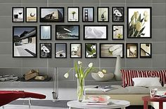 Black frames 3 different sizes - travel photos on dining room wall.