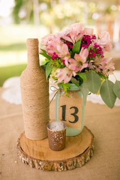 Beautiful rustic centerpieces to add an outdoor charm. The mason jars are a mint green, wine bottles wrapped in twine with and adorable metallic gold candle holder. Don't forget about the lovely wooden tree slices which are shellacked so they won't go full. I have 21 pieces. I can sell each piece separately or as a whole. Please email me if you are interested in steerage items.