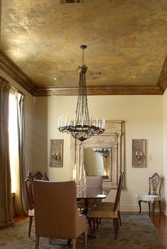 Ceiling… Aged Gold Ceiling | Pantelleria Designs. Love the gold ceiling! With raw timber beams, plants hanging from the beams, boho lanterns, raw timber shelving and display tables