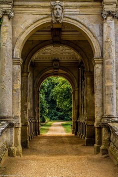 Palladian Bridge in beautiful Stowe Gardens. Stowe is a Capability Brown designed National Trust landscape garden in Buckingham, Buckinghamshire, England, with walking trails in 250 acres of fine landscaped gardens filled with lakes, temples and monuments. (V)