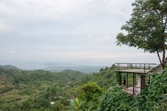 Bed & Breakfast in Tagaytay, Philippines. The Balcony Room is situated on the topmost part of the property.  Its view is the best!  The room has a four poster bed, with a balcony in the front.  It has to be experienced to be appreciated!  A room with a view!!  It is perched on top of the ...