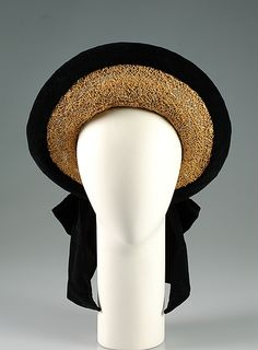 Hat  Walter Florell     Date:      ca. 1950  Culture:      American  Medium:      Straw, cotton  Credit Line:      Brooklyn Museum Costume Collection at The Metropolitan Museum of Art, Gift of the Brooklyn Museum, 2009; Gift of Mrs. Myles Friedman, 196