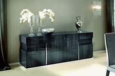 Elegant and attractive modern sideboard in grey gloss Koto wood. The overall appearance of this wonderful piece is enhanced by the gleaming chrome detailing and the contrast with the highly lacquered finish ensure this piece is both visually pleasing as well as functional. Ample storage space is provided within.