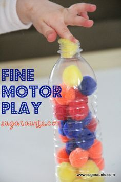 Fine Motor Play with crafting pom poms and a recycled water bottle. Play to improve tripod grasp, finger isolation, bilateral hand coordination, colors.