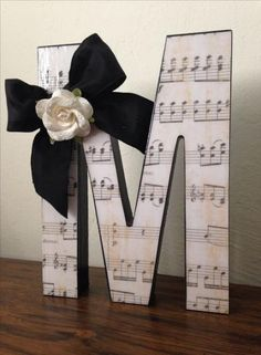 Cute DIY gift for music teacher.use their initial, school name initial, etc. - Cute DIY gift for music teacher…use their initial, school name initial, etc. Music Teacher Gifts, Music Gifts, Teacher Appreciation Gifts, Diy Gifts For Teachers, Music Teachers, Sheet Music Crafts, Sheet Music Decor, Music Themed Parties, Wedding Table Names