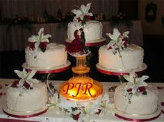 yummy and gorjuss indian themed wedding cakes…this is perfect, I have 5 kids - would love this with the name of each of my kids on the cakes Cheap Wedding Cakes, 3 Tier Wedding Cakes, Indian Wedding Cakes, Wedding Cake Roses, Themed Wedding Cakes, Wedding Cakes With Cupcakes, Elegant Wedding Cakes, Wedding Cake Designs, Fountain Wedding Cakes