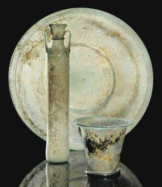 A LARGE ROMAN GREEN GLASS BOWL - CIRCA 2ND-3RD CENTURY A.D.