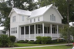 white farmhouse with porch