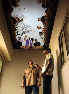 Ceiling mural in smoking area.