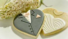 La novia y el novio de corazón decorado galletas