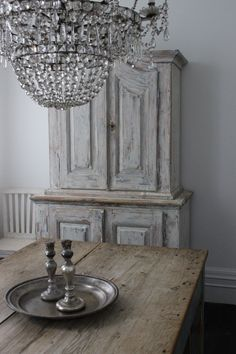 Beautiful chandelier with rustic table