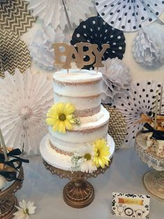 Elegant naked cake at a white, black and gold baby shower party! See more party planning ideas at CatchMyParty.com!