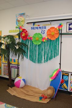 Dollar Tree serving platters turned into flowers for a summer luau backdrop. String up by drilled holes and using jute. Wrap leis around and attach DT hula skirt grass. HaveAShindig.com