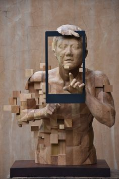 Dynamic Pixelated Wood Sculptures Are Contemporary Masterpieces - Taiwanese artist creates wooden sculptures that look like digital glitches