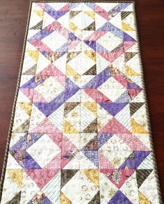 Quiltspiration! This tablerunner was made with the Quilt Block Recipe Card from our June Sew Sampler monthly subscription box. It was made with the Wild Orchid fabric collection. Subscribe and get your fabric today at the FQS website! #fqsfun #sewsampler #sewsamplerbox #quilt #quilts #quilted #sew #sewing #fabric #fabrics #blackbirddesignsfabric #showmwthemoda #wildorchidfabric #fatquartershop @modafabrics