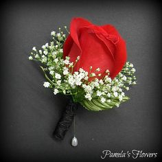 Boutonniere by Pamela's Flowers – Full-size red rose, fresh white babies breath, green leaves, and black chiffon stem wrap. See more homecoming and prom designs at pamelasflowers. Red Rose Boutonniere, Red Rose Bouquet, Corsage And Boutonniere, Homecoming Flowers, Prom Flowers, White Wedding Flowers, Prom Bouquet, Red Bouquet Wedding, Red Wedding