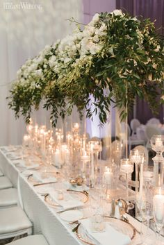 Tall Greenery Wedding Centrepieces, Floating Candle Wedding Centrepieces, Clear Wedding Table Setting, White Wedding Table Setting | Romantic All White Wedding Reception | ElegantWedding.ca