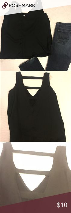 Black satin v neck tank w back details! Black silky forever 21 top! Front is a flattering v neck, back is also a v with three cross panels! So cute with blue jeans and a high pony! ‼️ please feel free to comment with any additional questions! I'll always take the best offer!‼️ Forever 21 Tops Tank Tops