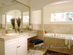 makeup area, tub in front of window