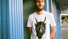 About Keaton Henson's T-Shirt Every bit the artist, behind the beard is Keaton Henson. He caught our attention with his stunning songs and used his illustration