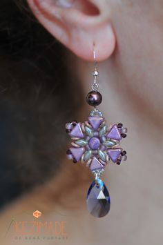 Handmade earrings with Swarovski crystals, pearls and sterling silver.