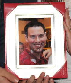 """My husband's family does a white elephant gift exchange every Christmas. I knew I wanted to come up with something great for this year's exchange, and I totally found it. Frame an autographed picture of yourself!"""