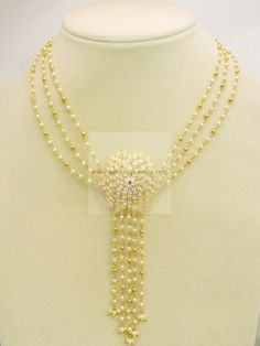 Necklaces / Harams - Gold Jewellery Necklaces / Harams (NK259612410-15) at USD 1,447.09 And EURO 1,287.05