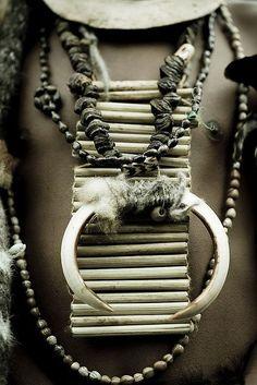 Papua New Guinea   Tribesmen jewels..Pigs teeth, shells, dry seeds, opossum fur…