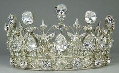 Gorgeous silver plated tiara set with clear crystals.  Wish I knew more info about it.