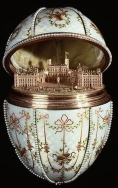 1901 - The Gatchina Palace Egg. Presented to Empress Maria Feodorovna. Workmaster: Mikhail Perkhin. Surprise: The egg opens to reveal a miniature gold replica of the palace at Gatchina. Owner: Walters Art Museum, Baltimore.
