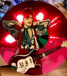 "Ziggy Played Guitar  Artist: Patricia Rodriguez  medium: acrylic paint, gloss, glitter, 15"" red see thru vinyl Phonograph record, 12"" vinyl record, metal box, LED lights, mylar, epoxy.  http://www.tigerbeearts.com"