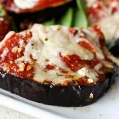 I was just imagining these earlier this week! Perfect timing - I have two eggplants in the fridge...Eggplant Pizzas (via foodily.com)