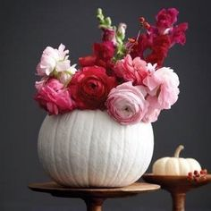 A very pretty fall floral arrangement! Spray paint pumpkins white and use as vases