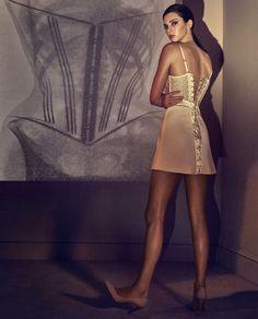Kendall Jenner wears the Macramé Tale dress in silk georgette, silk satin and macramè panels