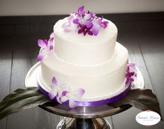 PLUMERIA FLOWERS ON A WEDDING CAKE | ... . The flowers used to decorate the cake are fresh singapore orchids