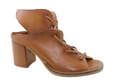 Tan sandal from Mjus with cord lacing up the front sandal