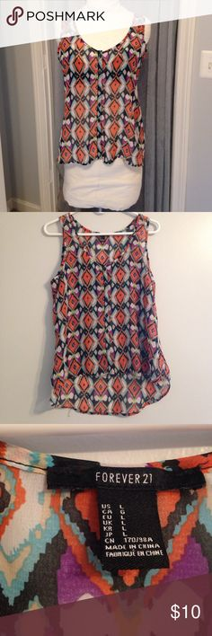 "🆕 Listing! Forever 21 Hi-Lo Tank Top Reposh item, gorgeous multi-colored diamond patterned, semi-sheer tank top. Striking orange & purple, polyester fabric, this garment has no stretch but is so cute! Measurements laying flat: chest 19"", waist 21"", bottom 24"", length from bottom of neckline to hem 15"", length in back 25"" Forever 21 Tops Tank Tops"