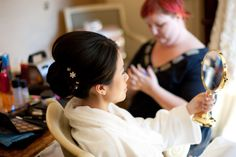 Beautiful bride getting her hair and make-up done! Love this pic. Photo by Roee #MinnesotaWeddingMakeupArtist