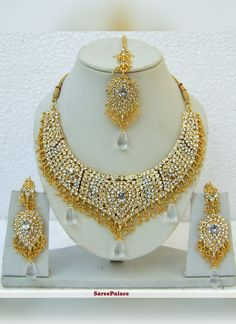 Buy Stone Studded Necklace Set in White and Golden online,Item code: Occasion: Wedding, Fabric: Alloy Metal, Gender: Women Indian Bridal Jewelry Sets, Indian Jewellery Online, Wedding Jewelry, Pearl Necklace Set, Necklace Types, White Necklace, Bollywood Jewelry, Fashion Jewelry Necklaces, Gold Jewellery