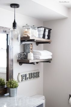 This Industrial Farmhouse Bathroom is the perfect blend of styles and creates such a cozy atmosphere!