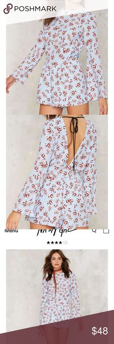 🆕 nasty gal Romper NWT powder blue Romper with a floral print. Open back with a black string at the neckline. Bell sleeves. Size L.   ✅ offers/negotiations (please no lowballs!) ✅ modeling (if the item fits me!) ✅ bundles / bundle discounts ✅ reserves (up to two weeks) 🚫 trades/swaps 🚫 PayPal Nasty Gal Dresses