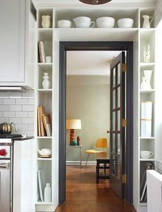 17 Tiny but Mighty Spaces with Killer Design// I like the idea of built-ins in the kitchen doorway- for recipes and big servingware!