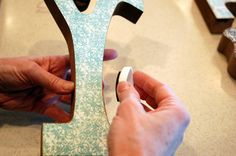 How to mod podge paper onto letters.