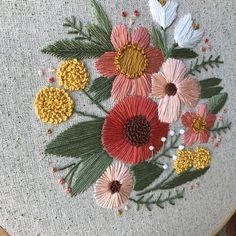 A beautiful array of peach, coral, pink, and yellow flowers is hand-stitched on natural onasburg fabric, set in a 9 wooden embroidery hoop. This is a unique piece for a nursery or vintage space. The texture and colors of the flowers are gorgeous! -Made to Order -Colors are customizable