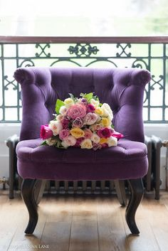 Purple armchair and roses.