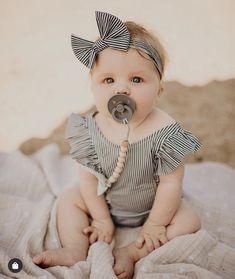 The cutest baby girl with our pacifier clip! #thebabyniche #sootherclip #pacifier #pacifierclip #teether #teething #babyaccessories #babyessentials #babygear #babygift #babyshowergifts #babygirl #babyboy #babyproducts #babygiftideas #toddler #toddlerlife #momlife #canadian #handmade #babylove #babyaccessory #colorblock #babygirlclothes #babygirlfashion #bows #babyclothes #babystuff #babystyle #romper Cute Baby Girl, Cute Babies, Baby Shower Gifts, Baby Gifts, Handmade Baby Items, Cute Baby Pictures, Baby Teethers, Baby Bows, Baby Girl Fashion